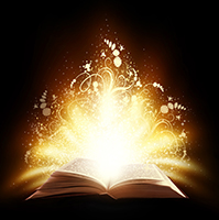 Open book with sparkly accents on black background