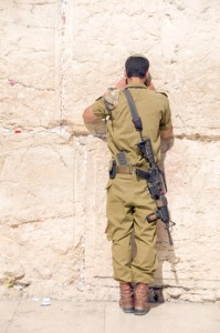 Israeli soldier praying at the Western wall