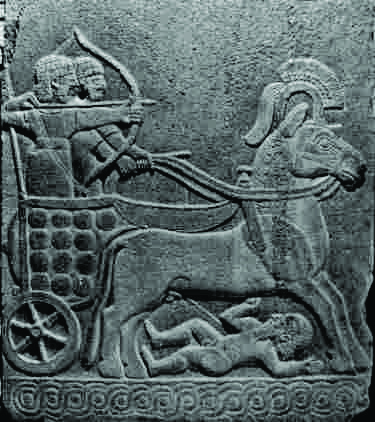 Hittite relief with a chariot and swirls