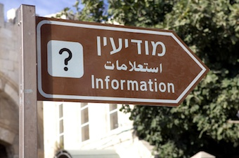 "Sign with a question mark and the word ""information"" in Hebrew, Arabic, and English"